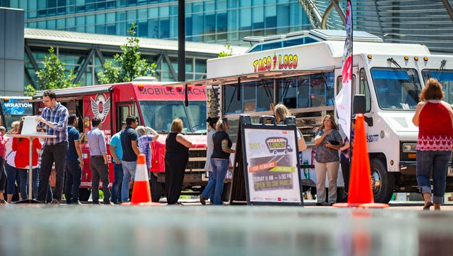Downtown Des Moines (DSM) residents and employees enjoy food vendors and entertainment during the Out to Lunch series Wednesday, June 13, 2018 at Cowles Commons in Des Moines, Iowa.