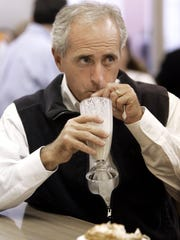 Nov. 1, 2006: Republican Bob Corker, a candidate for U.S. Senate, has a milkshake as he talks with voters at Hoskins Drug Store in Clinton, Tenn.