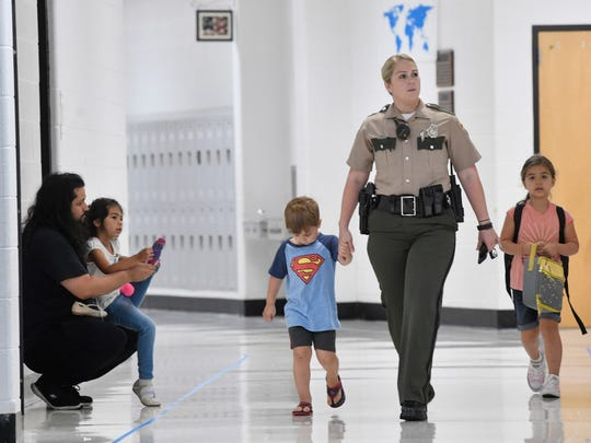 Kasey Ana looks for her daughter Mia's room as little brother Tito tags along on the first day of school at Elzie D. Patton Elementary School in Wilson CountyWednesday Aug. 1, 2018, in Mt. Juliet, Tenn.