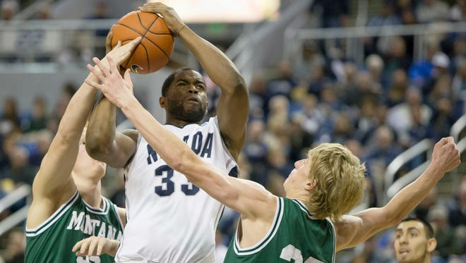 Nevada's Ronnie Stevens fights to get off a shot against Montana Tech Orediggers in an exhibition basketball game held at Lawlor Events Center on November 4, 2013 in Reno, Nevada.
