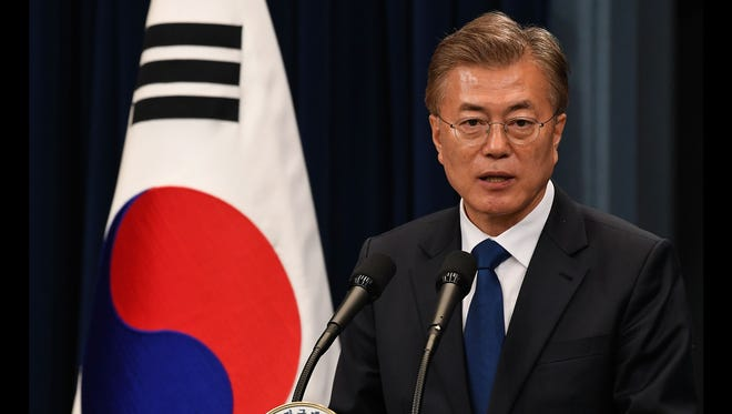 South Korea President Moon Jae-In speaks during a press conference at the presidential Blue House on May 10, 2017, in Seoul.