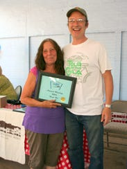 Sue Been poses with Silver City MainStreet Board President