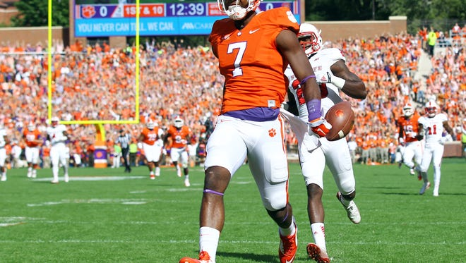 Clemson wide receiver Mike Williams (7) runs into the end zone past North Carolina State safety Hakim Jones (20) in the first quarter. Williams scored two touchdowns in the Tigers' 41-0 win over N.C. State in their 2014 game.