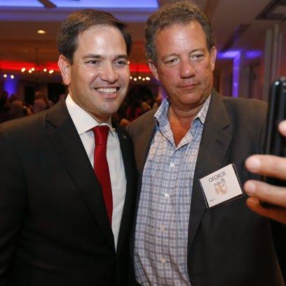 Sen. Marco Rubio, R-Fla., left, takes a selfie with