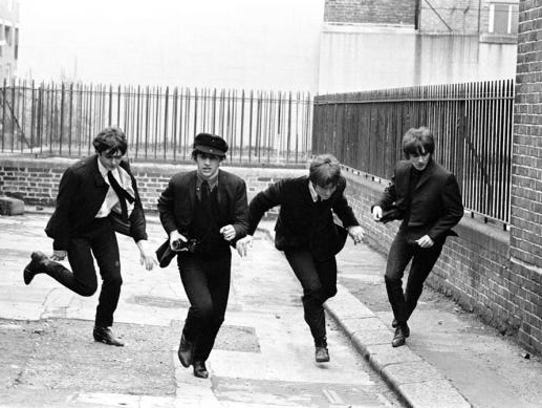 """A Hard Day's Night,"" starring The Beatles, is playing"