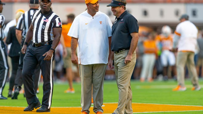 Georgia Head Coach Kirby Smart and Tennessee Head Coach Jeremy Pruitt  in the first half of a NCAA football game between Georgia and Tennessee in Knoxville, Tenn., on Saturday, Oct. 5, 2019.
