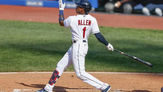 Cleveland Indians' Greg Allen hits a three run home run off Detroit Tigers pitcher Joe Jiménez during the ninth inning of a baseball game, Sunday, Aug. 23, 2020, in Cleveland. The Tigers defeated the Indians 7-4.