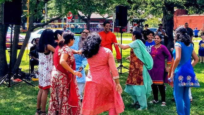 Guests and volunteers at India Fest dance during the celebration at Gage Park in 2017.