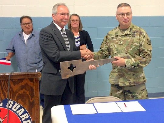Village of Santa Clara Mayor Richard Bauch receives a symbolic key of the National Guard Armory from Brigadier General Kenneth Nava during the transfer of the armory to the Village on Thursday morning.