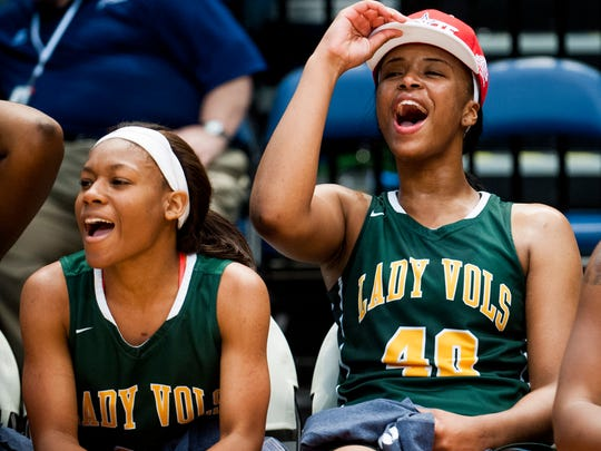 Jeff Davis' Ahyiona Vason and Jeff Davis' Jasmine Walker celebrate as they get their championship caps at the AHSAA basketball championship game at Legacy Arena in Birmingham, Ala. on Saturday March 5, 2016.