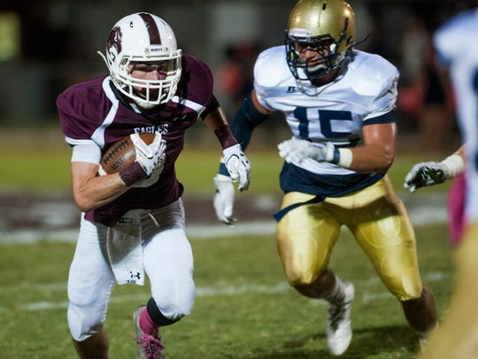 St. James'Atchison Hubbard (15) chases Alabama Christian's