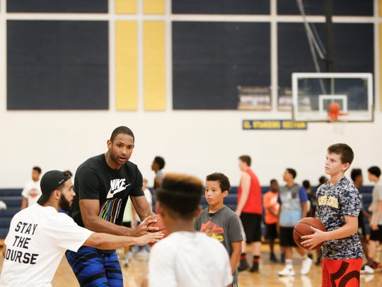 Grand Ledge alum and Boston Celtics big man Al Horford works on drills with kids last summer at Horford Hoop Plus Basketball Camp at Grand Ledge High School.