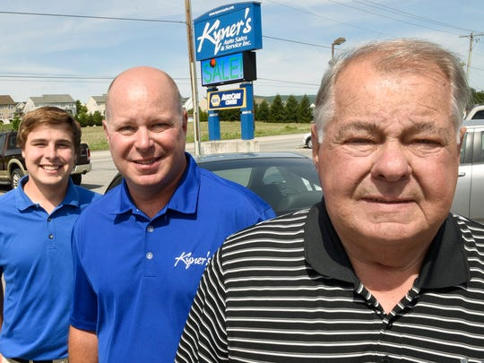 John Kyner, front, poses with his son, John III and his grandson Justin Kyner, left,  at Kyner's Auto Sales on Friday, June 10, 2016.