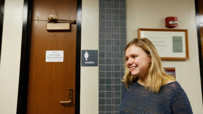 Junior Zoey Wagner, 17, stands next t the newly designated all-gender restrooms Wednesday, Feb. 24, 2016 at Roosevelt High School in Des Moines. Wagner said she is an ally to the LGBT community, and pushed for the gender neutral bathrooms to show her support for transgender students who may feel uncomfortable in regular boys and girls restrooms.
