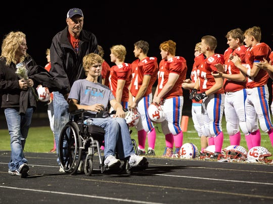 Caleb Kunckle is wheeled out with the rest of his team