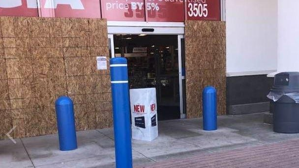 The entrance to Academy Sports was boarded up following an attempted break-in early Monday morning.