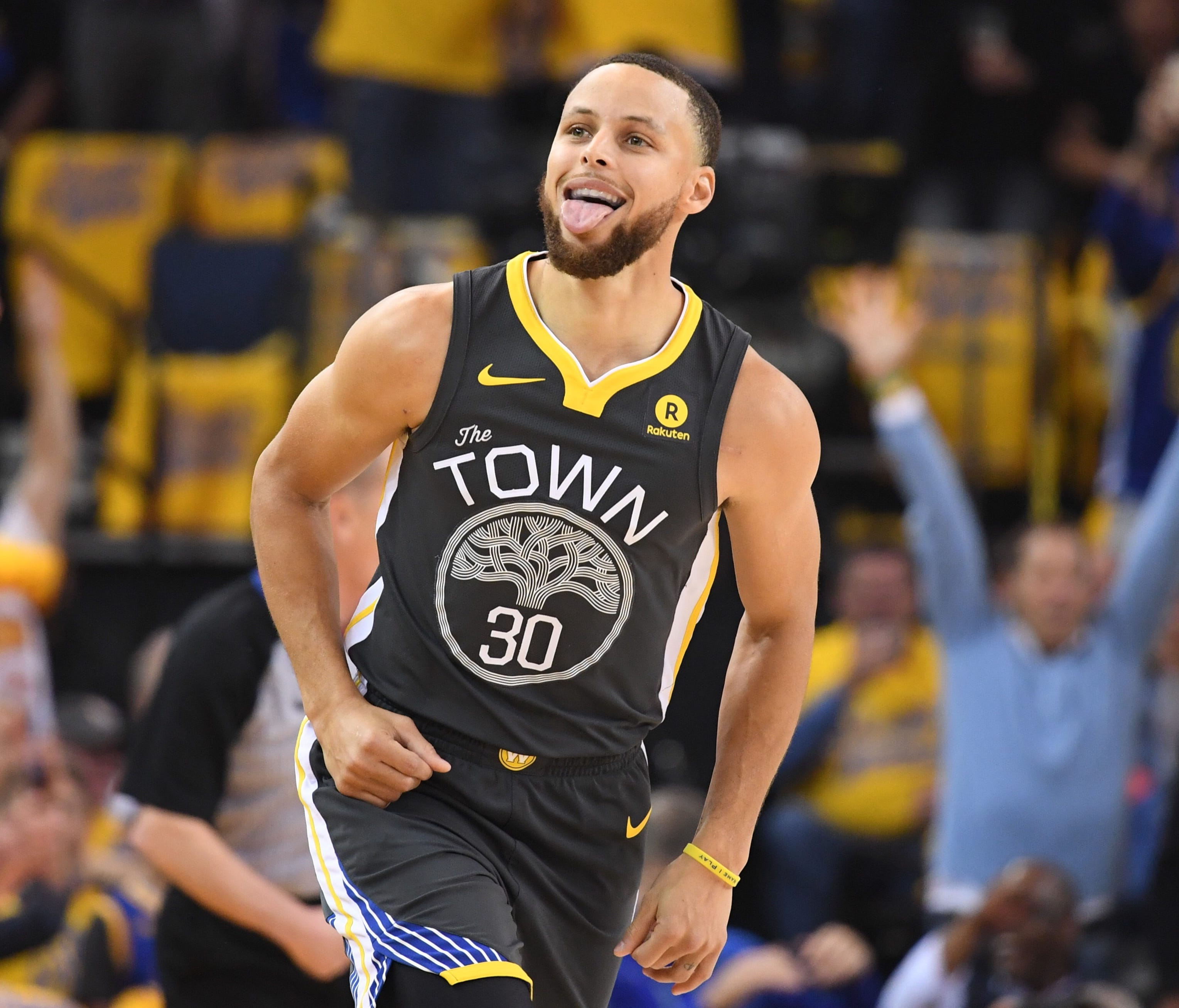 Stephen Curry celebrates after making a three-point basket against the New Orleans Pelicans during the first quarter of Game 2.