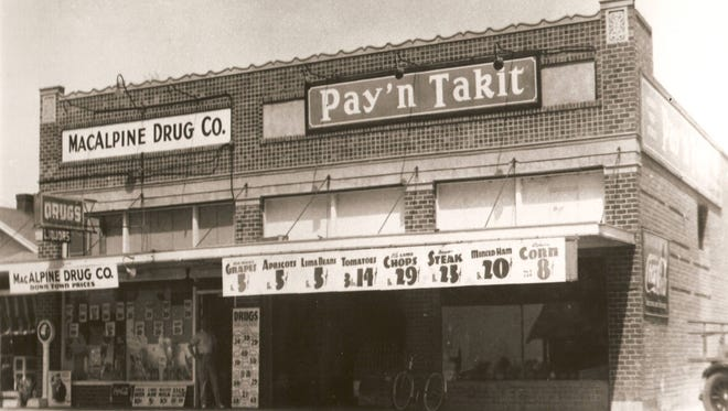 The MacAlpine Drug Co. and Pay'n Takit grocer circa 1938.
