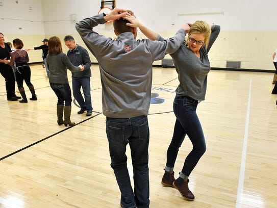 Tyler Koivisto and Jane Pietila work on a new move