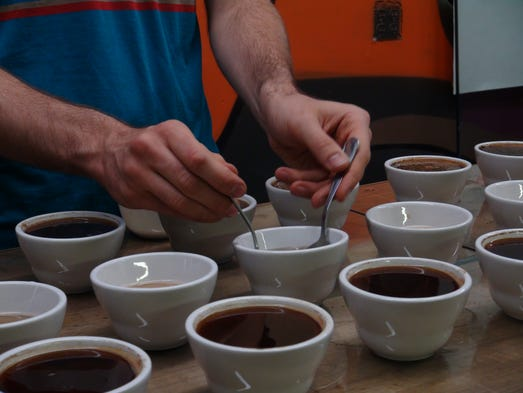 Cartel Coffee Lab in Tempe tastes coffee in cupping sessions before buying it.