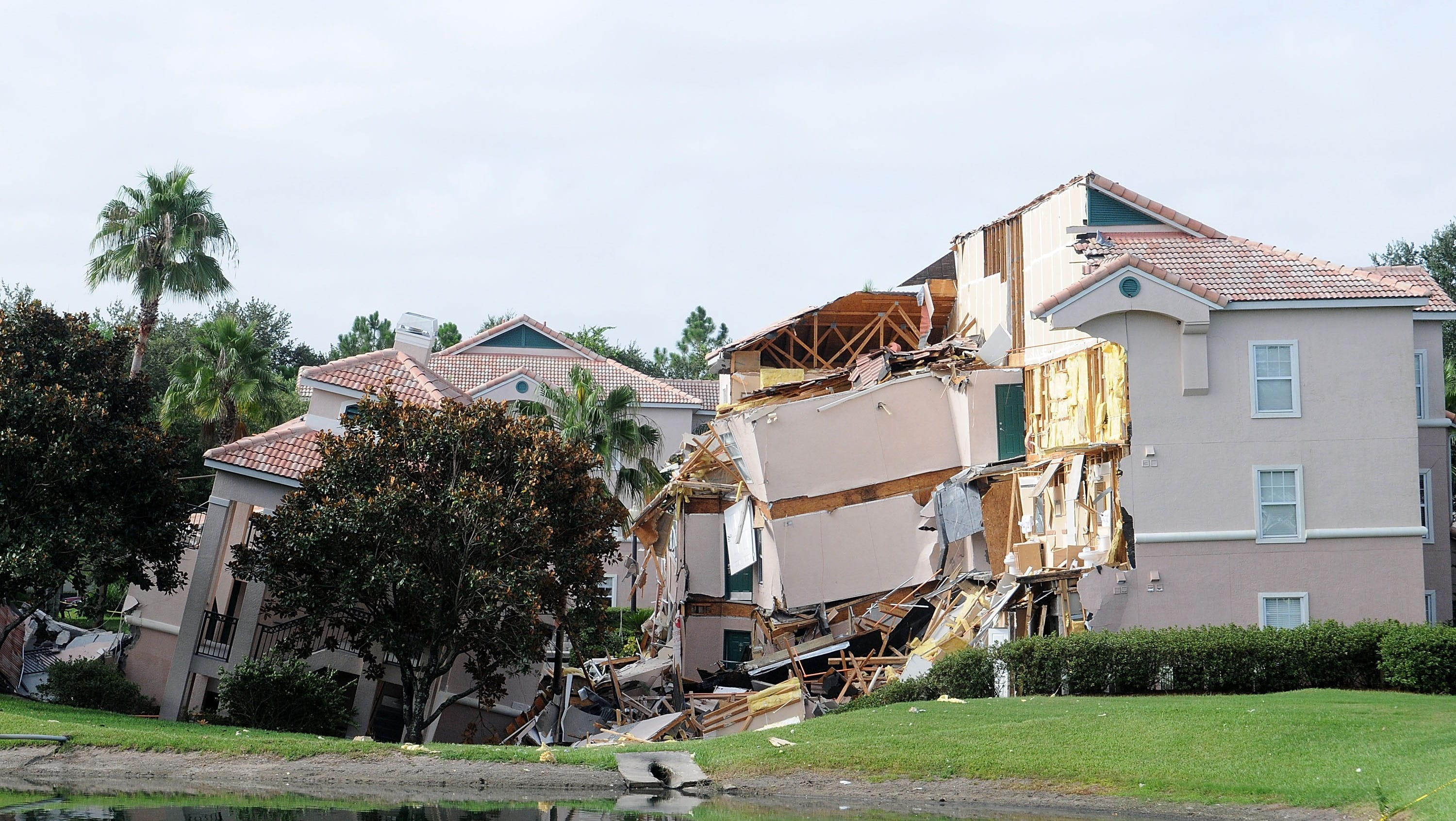 Part of a building fell into a sinkhole at Summer Bay Resort in Clermont.