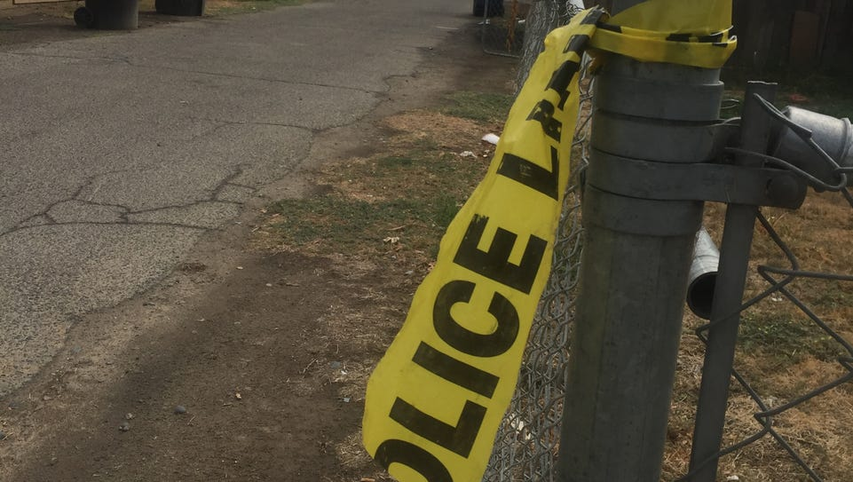 Remnants of yellow tape posted after officers responded