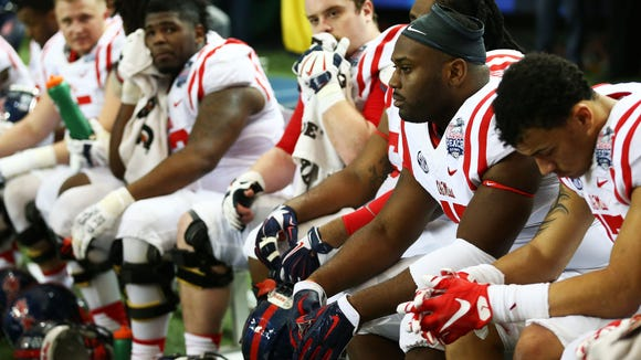 ATLANTA, GA - DECEMBER 31:  The Ole Miss Rebels react in the fourth quarter of their loss to the TCU Horned Frogs during the Chik-fil-A Peach Bowl at Georgia Dome on December 31, 2014 in Atlanta, Georgia.  (Photo by Streeter Lecka/Getty Images)