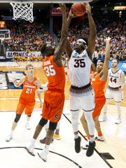 Arizona State's De'Quon Lake, center right, rebounds against Syracuse's Bourama Sidibe, center left, during the first half of a First Four game of the NCAA men's college basketball tournament Wednesday, March 14, 2018, in Dayton, Ohio.