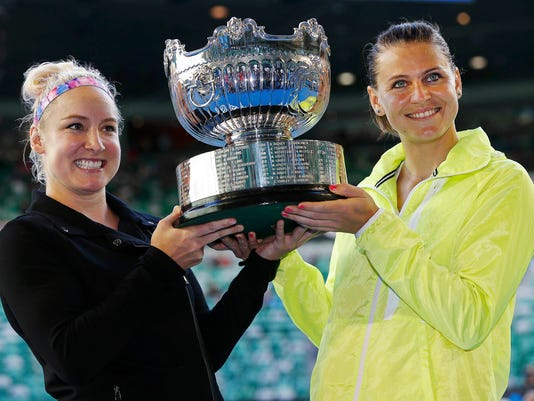 Mattek-Sands of the U.S. and Safarova of Czech Republic hold their trophy after winning their women's doubles final match against Zheng of China and Chan of Taiwan at the Australian Open tennis tournament in Melbourne