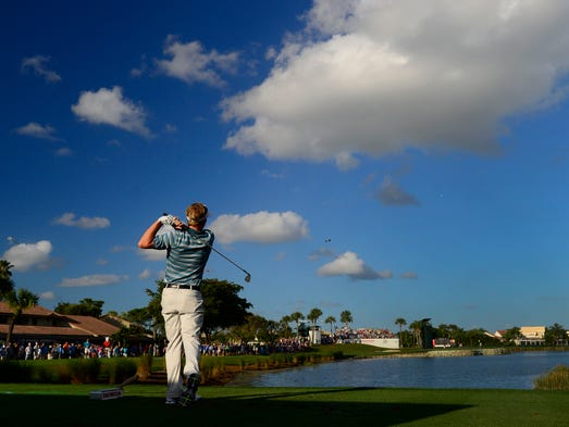 Champion Russell Henley tees off on the 15th hole during the final round of the Honda Classic at PGA National in Palm Beach Gardens, Fla.