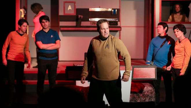 Capt. James T. Kirk played by Kenn Parks, center, addresses an alien race of beings as he is flanked by the crew of the Enterprise during a scene from the parody Star Trek:  Boldly Going Way Too Far at the Alley Theater.Aug. 18, 2016