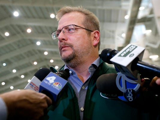 FILE - In this Jan. 14, 2016, file photo, New York Jets general manager Mike Maccagnan speaks to reporters at the team's NFL football training center in Florham Park, N.J. Maccagnan allowed himself to celebrate for a moment once he knew that Ryan Fitzpatrick was coming back to the New York Jets. The two sides ended a months-long contract stalemate by agreeing to terms on a one-year, $12 million deal on Wednesday, July 27, 2016. (AP Photo/Julio Cortez, File)