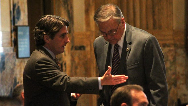 House Appropriations Chairman Cameron Henry, R-Metairie, and House Democratic delegation Chairman Gene Reynolds, D-Minden, discuss the budget bill on the House floor Friday.