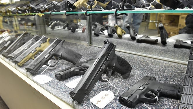Hand guns for sale at Shooter's Choice in Dover.  Gun permits issued in Delaware surged in December and January.