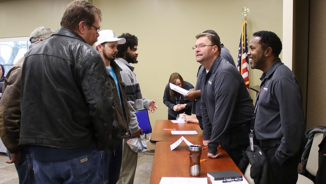 People gathered at the American Job Center on Madison Street for Hankook's hiring event held on Wednesday. Several departments of Hankook, including information technology, quality control and manufacturing, were on-site for interviews and potential hiring.
