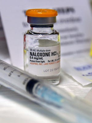 In this Feb. 19, 2014, photo, a small bottle of the opiate overdose treatment drug, Naloxone, also known by its brand name Narcan, is displayed at the South Jersey AIDS Alliance in Atlantic City, N.J. It is becoming easier for friends and family of heroin users or patients abusing strong prescription painkillers to get access to Naloxone, a powerful, life-saving antidote, as state lawmakers loosen restrictions on the medicine to fight a growing epidemic. Facing what's been called an opioid drug epidemic, Utah police, prosecutors and politicians are set to speak about how to investigate and prosecute heroin and other drug cases at the Utah Heroin and Opioid Summit in Salt Lake City.