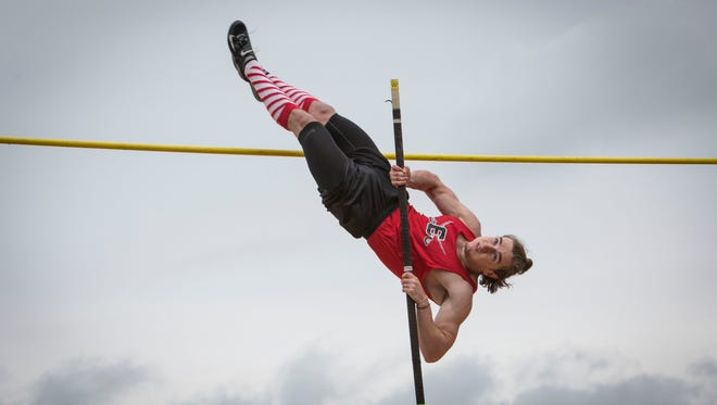 Emerson High School senior Eran Pecci vaults up and over the bar during the Bergen County Relays track championship at River Dell High School in River Edge on Saturday, April 22, 2017.