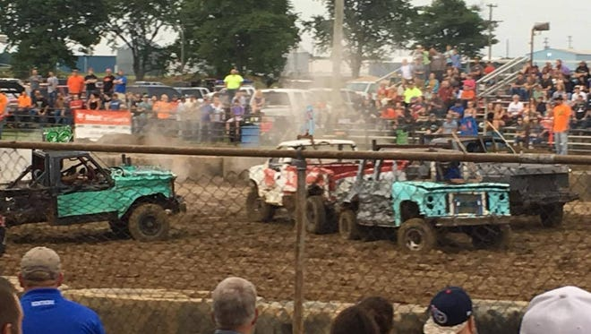 The crowd watches as the derby cars crash into each other during this year's demolition derby at the Union Co. Fair.