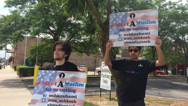 Damon Stengl, 18, and Ekaan Ahmed, 15, of Oshkosh, gave up three hours to stand in the hot sun on Saturday, July 22 and answer questions about their Muslim beliefs.  They were part of a presentation at the Fond du Lac Public Library, hosted by the Ahmadiyya Muslim Community, that serves the Fox Valley area and northern Wisconsin.