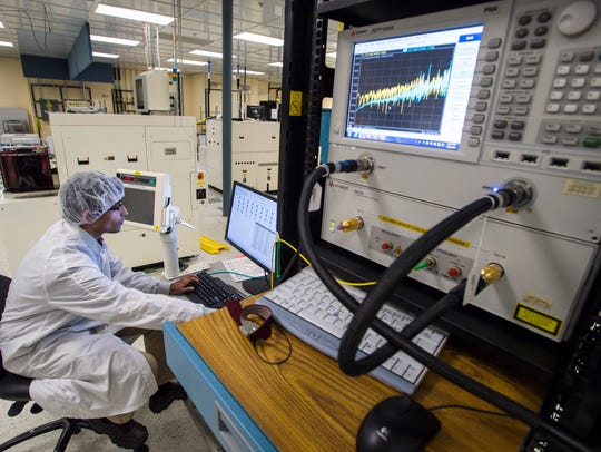 A technician tests logic devices at the GlobalFoundries