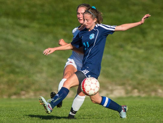 Champlain Valley Union's Sydney Jimmo, left, boots