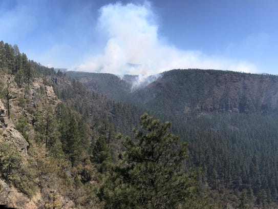 Officials are investigating a 'human-caused' wildfire