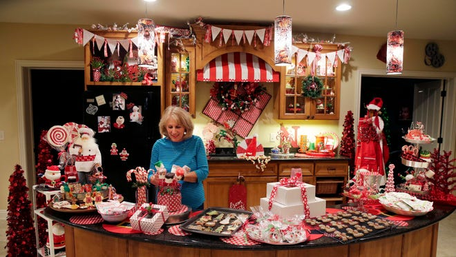 Nikki Bruneau (with the help of Nancy Buntrock, not pictured) created Santa's Sweet Shoppe for the fantasy house.