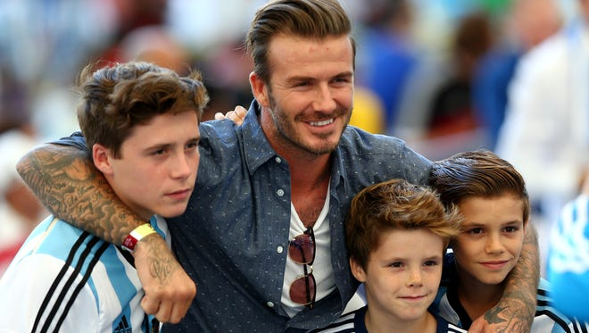 David Beckham and sons Brooklyn Beckham (L), Cruz Beckham (2nd R) and Romeo Beckham (R) prior to the 2014 FIFA World Cup Brazil Final match between Germany and Argentina at Maracana on July 13, 2014 in Rio de Janeiro, Brazil.