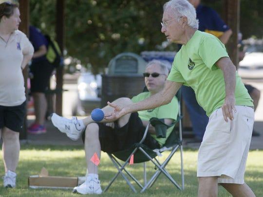 Senior Olympian Pete Serini plays bocce ball.