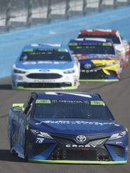 Martin Truex Jr. (78) comes around a turn in the 67th lap during the Can-Am 500 on Sunday.
