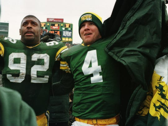 Brett Favre and Reggie White leave the field after a game against the Chicago Bears at Lambeau Field during the 1994 season.