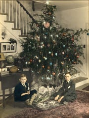 Frank H. Davis Jr. and John G. Davis sit in front of a Christmas tree pre-World World II.