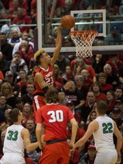 Center Grove's Trayce Jackson-Davis (23) dunks the