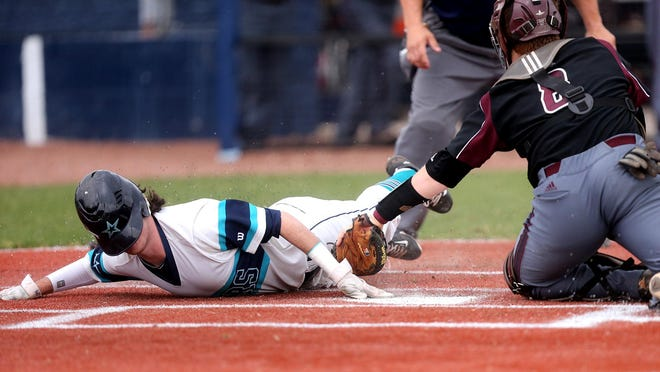 Despite the helmet sliding in front of Siegel's Jordan Middleton (7) face he is able to touch homeplate before being tagged out by Collierville's catcher Mattew Loeffler (8) during Game 5 of the 2016 TSSAA Class AAA State Baseball Tournament, on Wednesday, May 25 2016.